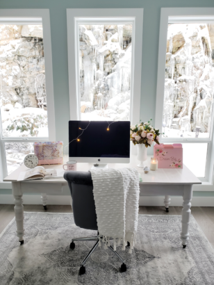 White vintage desk in feminine office with pink accessories
