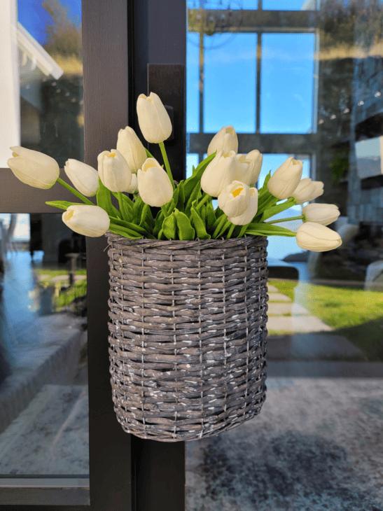 Door basket with white tulips